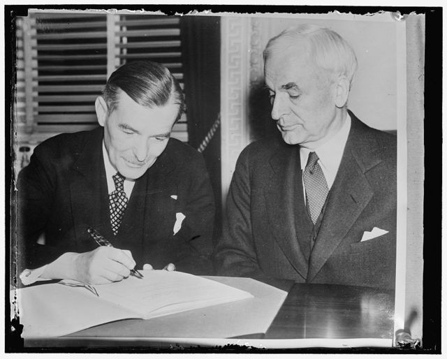Sign Trade Agreement. Washington, D.C., The United States and Czechoslovakia signed today a trade agreement designed to maintain and improve the mutually beneficial trade relations between the two countries. Photo shows Secretary of State Cordell Hull, who signed for the United States (right) as he watched the Czechoslovakian Minister Vladimir Hurban sign the document