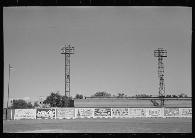 Signs and lighting standards at baseball park, Saint Paul, Minnesota