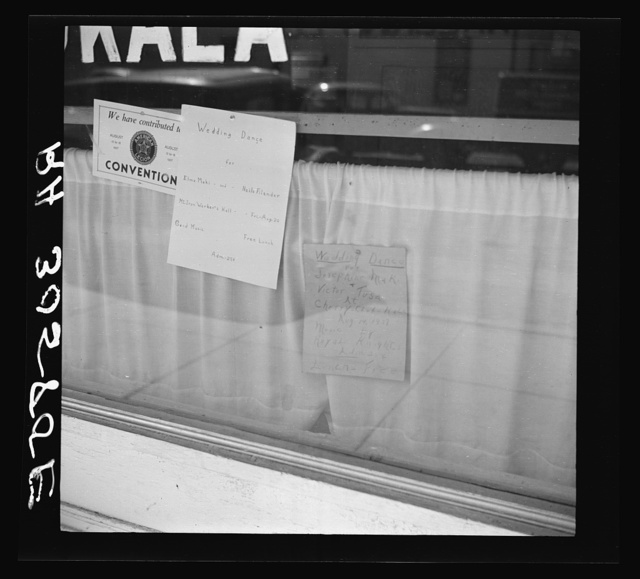 Signs in store window. Virginia, Minnesota