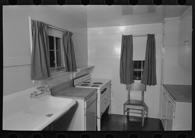 Sink, refrigerator and stove in the kitchen of the model house at Greendale, Wisconsin