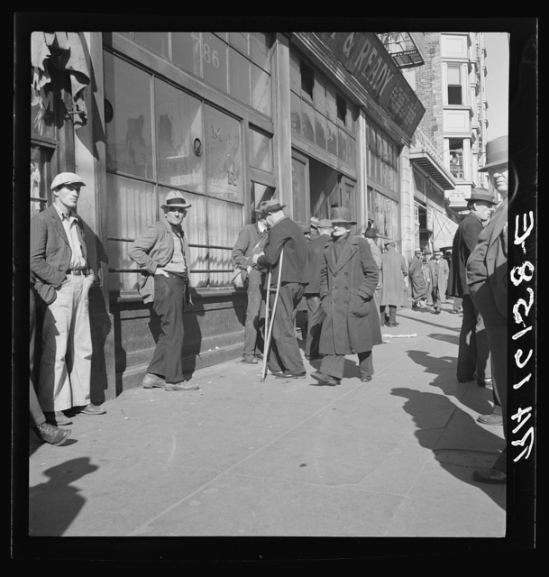 """Skid Row."" Howard Street, the street of the unemployed in San Francisco, California"