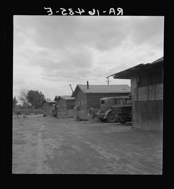 Slums of East El Centro, California. Housing for Mexican field workers. They rent for eight dollars a month. Imperial Valley
