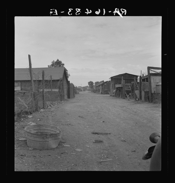 Slums of East El Centro, California. Typical of housing and sanitary conditions of Mexican field workers of the Imperial Valley. The houses rent for eight dollars a month
