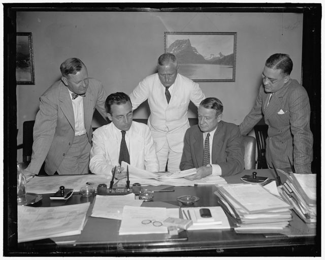 Social Security Board [...] Seated, left: Arth [...] Director [...] right; [...] Bureau standing [...]orson, Assistant Executive of Fed[...]