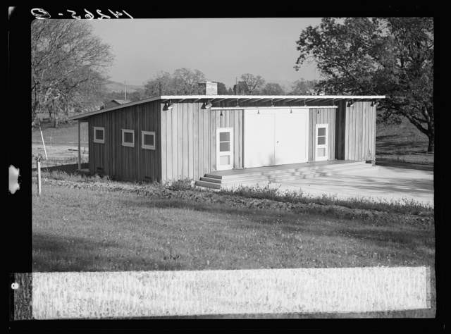 Sonoma, California. Farm Security Administration camp for migratory agriculture workers. Wooden community building and concrete platform