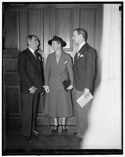 Speakers at Red Cross opening. Washington, D.C., May 10. The principal speakers at the opening of the annual meeting of the National Red Cross are shown talking together before the ceremonies began. Left to right: Admiral Cary T. Grayson, Chairman of the National Red Cross; Miss Elizabeth Fox, of Yale University; and Vicomte Bonades of Rouge, General Secretary of the League of Red Cross Societies, the Vicomte is from Paris, France, 5/10/1937