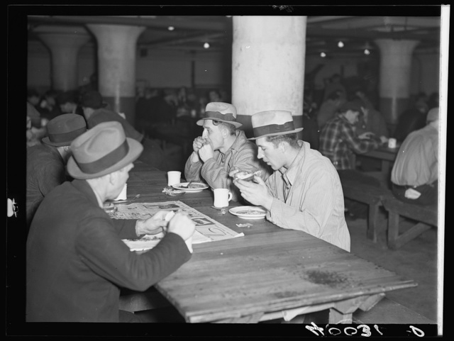 Strikers eating in cafeteria in Fisher body plant factory number three. Flint, Michigan