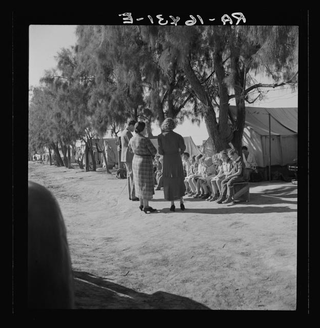 Sunday school for migrant children in a potato pickers' camp. Kern County, California