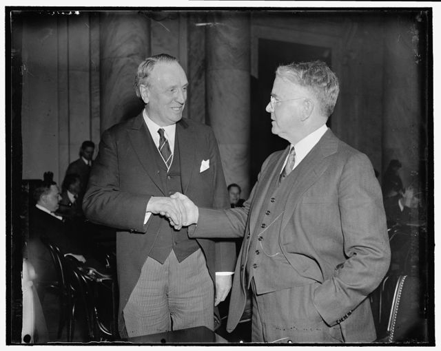 "Teacher and scholar meet again. Washington, D.C., April 1. Memories of school days were recalled today when Dean Harry M. Bates of the Michigan Law School, faced Senator Henry F. Ashurst, Chairman of the Senate Judiciary Committee, across the witness table in voicing his opposition against the President's court reform plan. Senator Ashurst was a student in Dean Bates' (right) law class at Michigan in 1903. As he and Dean Bates met, Senator Ashurst said: ""If I have made a failure at law, I'm going to blame it on you,"" 4/1/1937"