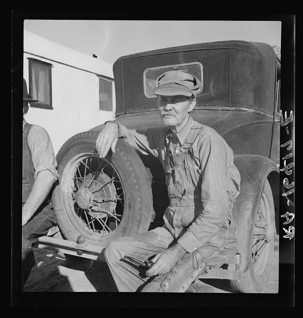 Texans and Oklahomans, drought stricken ex-farmers, are fast supplanting Mexican labor in the California harvests. Oklahoman from Chickasaw in potato pickers' camp. Kern County, California