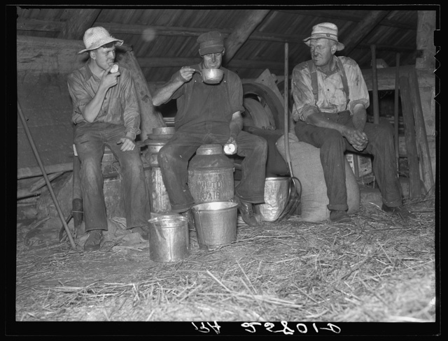Threshers stopping for a drink. Caledonia County, Vermont