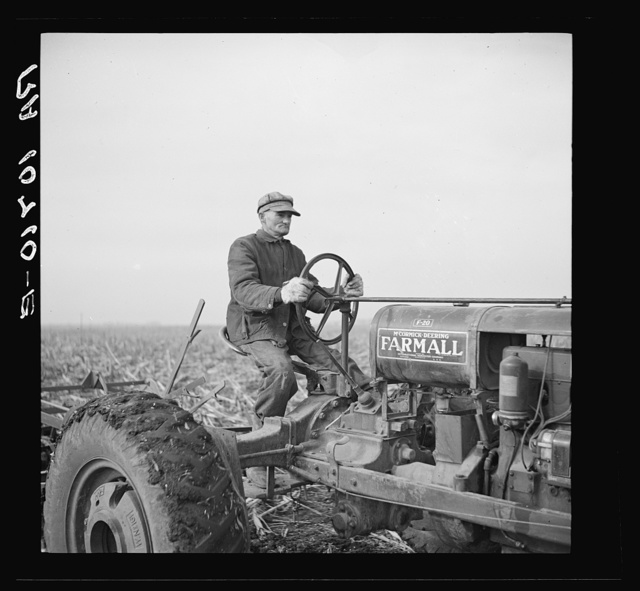 Tip Estes operating a tractor. Near Fowler, Indiana