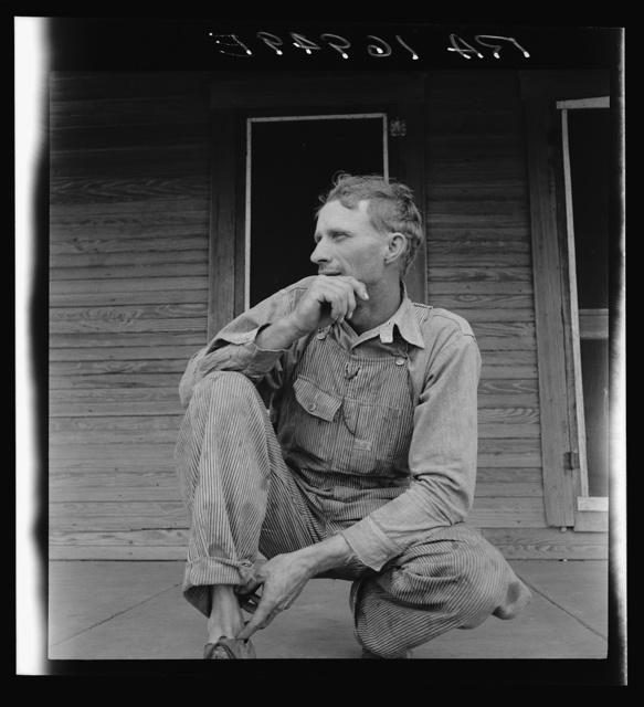 Tractor driver on cotton farm near Memphis, Texas