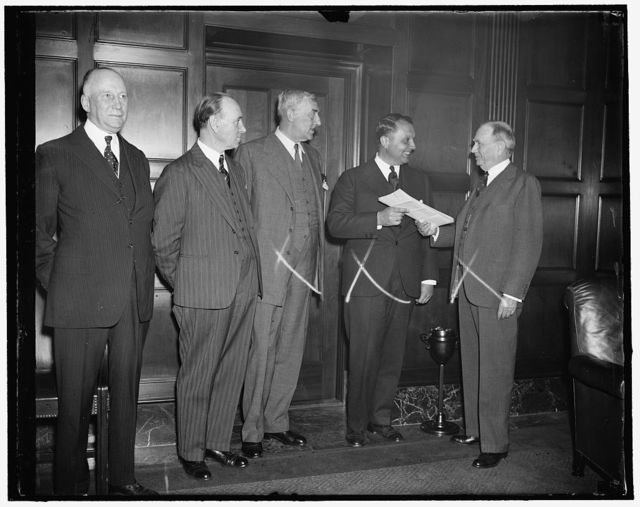 Trans-Atlantic permits handed out. Washington, D.C., April 20. The Dept. of Commerce today awarded permits to the Pan American Airways from Great Britain, Canada and the Irish Free State. These permits are all non-exclusive and convey flying rights in and out of these countries for Trans-Atlantic Air service between New York and London. Left to Right: Sir Herbert Marler, the Canadian Minister; Michael MacWhite, Irish Minister; Sir Ronald Lindsay, the British Ambassador; Juan T. Trippe, President of Pan American Airways who is receiving the permits from the Secretary of Commerce Daniel Roper, 4/20/1937