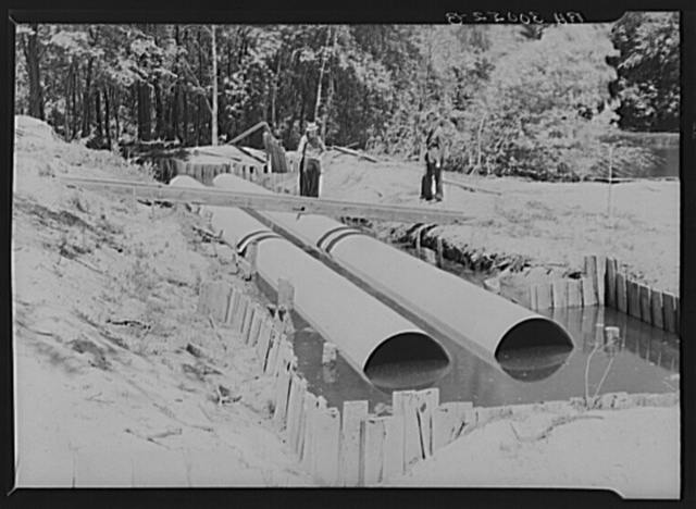 Two pipes designed to provide drainage for a bayou across which a dike will be built. Allegan Project, Michigan
