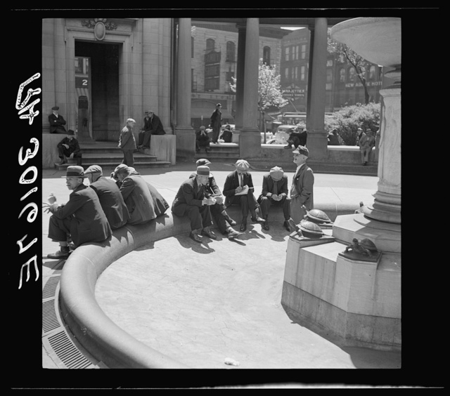 "Unemployed men sitting in public square in the Minneapolis ""Gateway"" district. Minnesota"