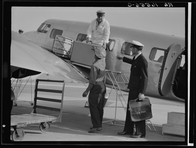 Unloading baggage for inspection after arrival of plane from Mexico. Glendale Airport, California