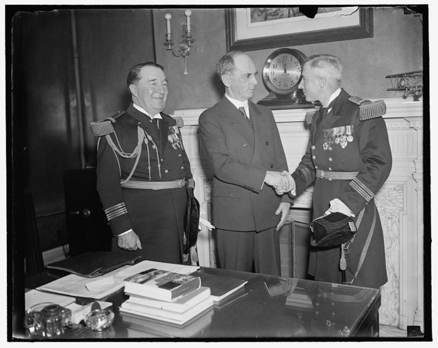 U.S. Chief of Naval Operations greets Skipper of visiting French Cruiser. Washington, D.C., March 24. Capt. H.P. Latham, Skipper of the French Cruiser Jean D'Arc no visiting American ports, was received by admiral William Leahy, (center) Chief of Naval Operations today. On the left is Capt. Louis Sable, Naval Attache of the French Embassy, 3/24/1937