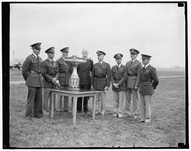 U.S. Flyers win Mackay Award. Washington, D.C., May 8. Nine officers and enlisted men of the U.S. Air Corps were today presented with the Mackay trophy for 1936 as a reward for the heroic flight under unfavorable weather conditions from Langley Field, Va., to Allecan, Mich., last August. The trophy, which is awarded annually for the most meritorious air plane flight of the year, was presented to the flyers at Bolling Field, D.C., by Maj. Gen. Malin Craig, U.S. Chief of Staff. In the photograph, left to right: Sergt. Frank B. Connor; Capt. Richard D. Nugent; Lieut. Edwin G. Simenson; Charles F. Horner, President of the National Aeronautic Association; Maj. Gen. Malin Craig; Lieut. Burton W. Armstrong; Lieut. Herbert Morgan, Jr.; and Lieut. William P. Ragsdale, 5/8/1937