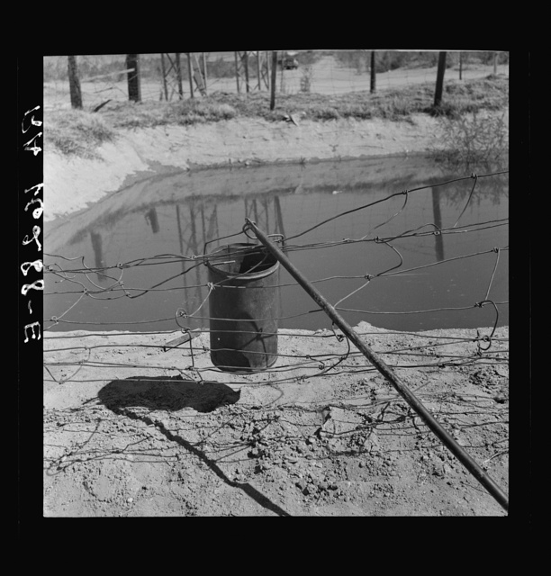 Water supply: an open settling basin from the irrigation ditch in a California squatter camp near Calipatria