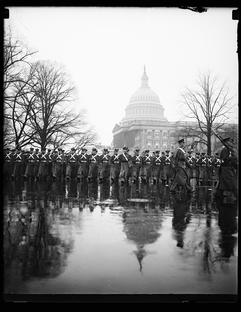 WEST POINT CADETS, WASHINGTON, D.C. JANUARY 20. DESPITE THE HEAVY DOWNPOUR, THE WEST POINT CADETS PRESENTED A SNAPPY APPEARANCE AS THEY MARCHED IN THE INAUGURAL PARADE TODAY