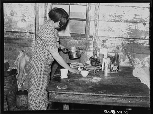 Wife of Joe Kramer working in the kitchen. Farm near Williston, North Dakota