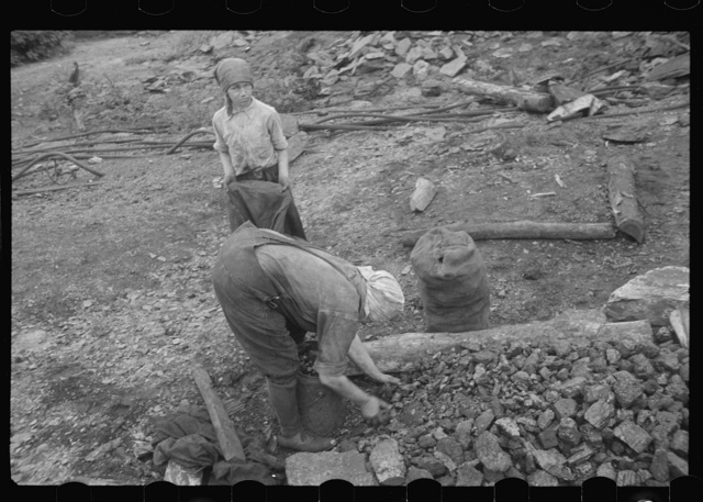 Woman and child picking coal from a slag heap. They are paid ten cents for each 100 pound sack, Nanty Glo, Pennsylvania