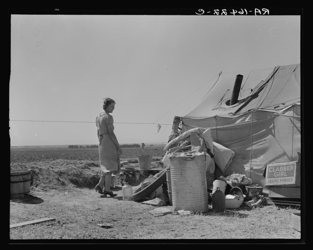 Young family just arrived from Arkansas camped along the road. Imperial Valley, California