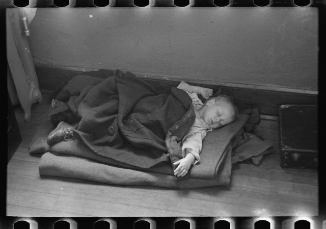 Young flood refugee asleep in schoolhouse, Sikeston, Missouri