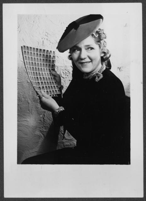 [Actress Mary Pickford, a strong supporter of women's rights, buys the first sheet of equal rights seals.]