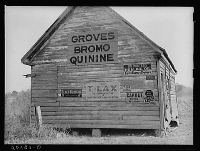 "Advertising Bromo-Quinine used in South for malaria and other ""remedies"" on side of old shack near Summerville, South Carolina"