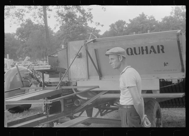 Attendant at farm machine display at county fair, central Ohio