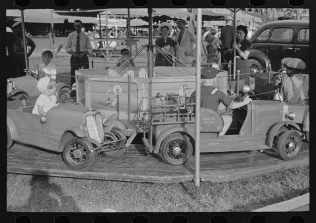 Automobile merry-go-round for the children, state fair, Donaldsonville, Louisiana