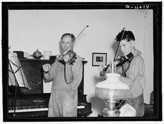 Barto, Berks County, Pennsylvania. Thomas Evans, a FSA (Farm Security Administration) client, giving a violin lesson to one of the neighbor's boys