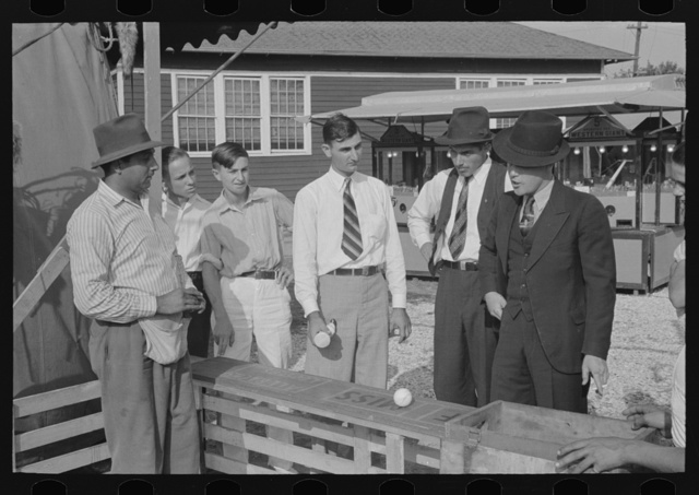 Baseball-throwing concession with man about ready to buy a throw, state fair, Donaldsonville, Louisiana