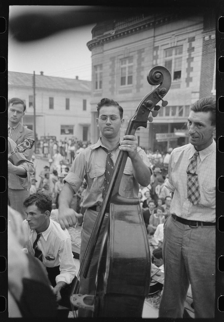 Bass viol player, Cajun band contest, National Rice Festival, Crowley, Louisiana