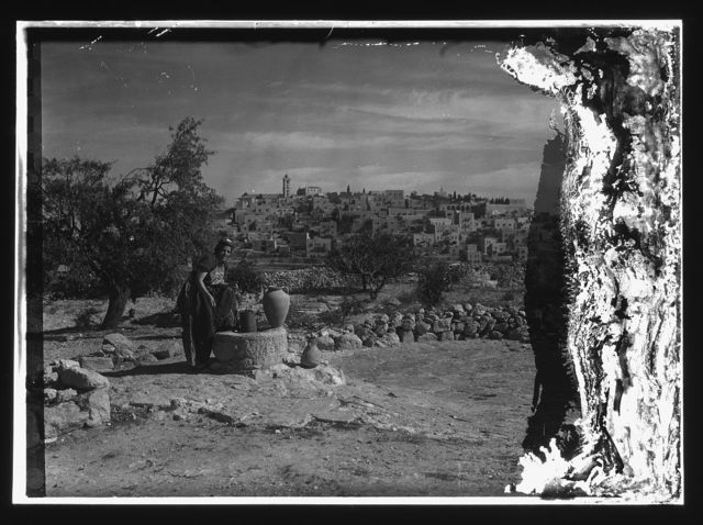 [Bethlehem from south with woman figure (Sofie) at the well clad in richly embroidered costume]