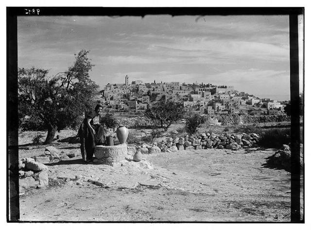 Bethlehem from south with woman figure (Sofie) at the well clad in richly embroidered costume