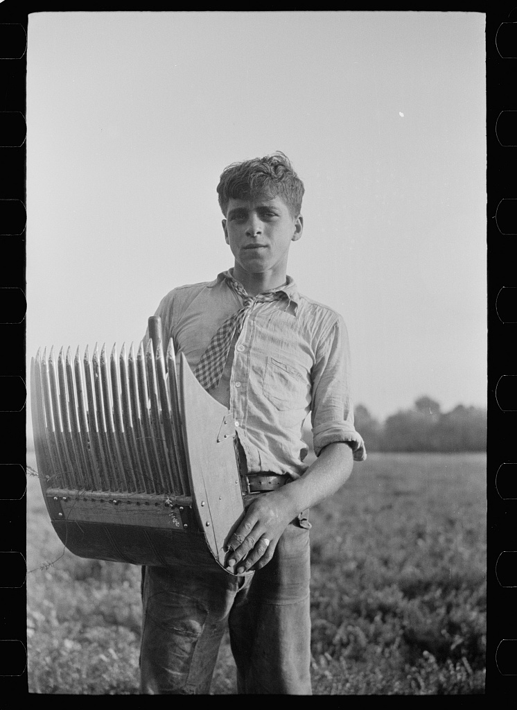Boy with cranberry scoop, Burlington County, New Jersey