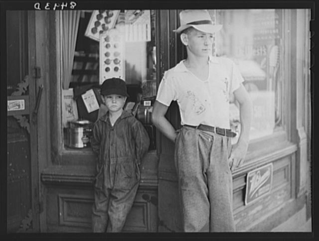 Boys in front of drugstore. Dover, Delaware