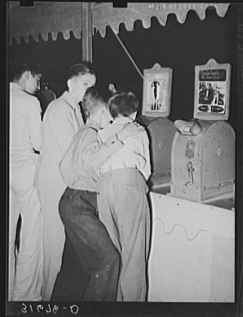 Boys looking at penny movies at South Louisiana State Fair. Donaldsonville, Louisiana