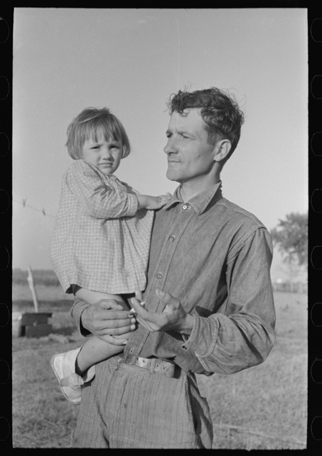 Cajun sugarcane farmer with daughter, near New Iberia, Louisiana