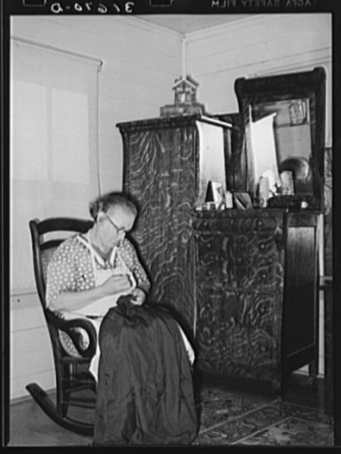Cajun woman patching in corner of living room. Near Crowley, Louisiana