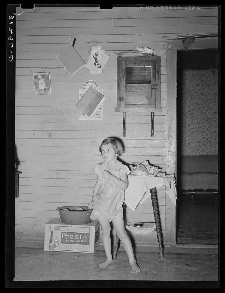 Child of sharecropper in old home. Family will work under the tenant purchase program. Near Caruthersville, Missouri