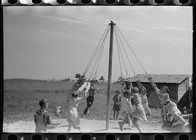 Children swinging on maypole, La Forge, Missouri. Project school at Southeast Missouri Farms