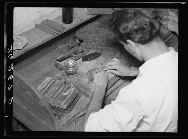 Cigar workers, stranded when factories moved north, turn to manufacturing in their homes. Key West, Florida