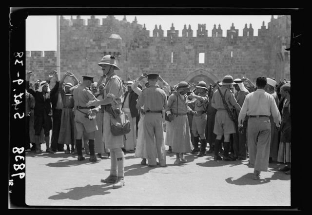 Close-up of military & police raid for arms on Arabs at Damascus Gate, Sept. 9, '38. Black Watch officer & troops