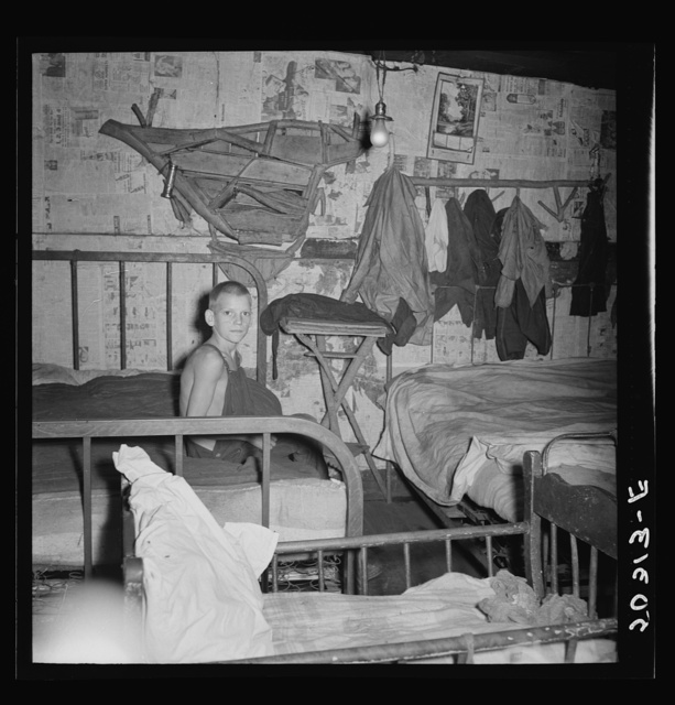 Coal miner's son in bedroom of company house. Pursglove, Scotts Run, West Virginia