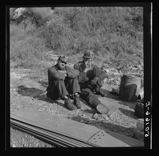 Coal miners waiting along road for bus to take them home. In Welch, Bluefield section, West Virginia