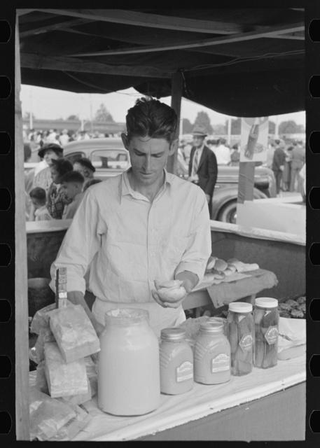 Concessionaire making a hamburger, state fair, Donaldsonville, Louisiana